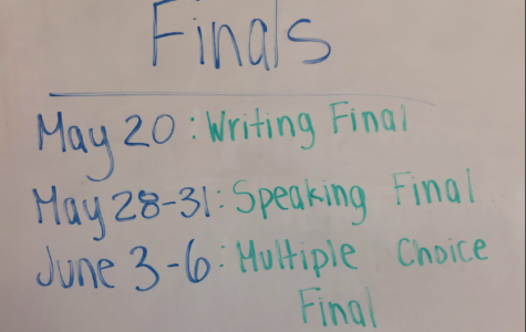 The dates of the Spanish II finals are posted in a classroom.
