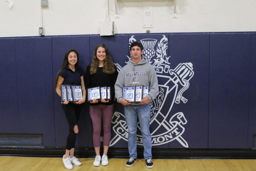 Kaimei+Gescuk%2C+Ashley+Trierweiler%2C+and+David+Bedrosian+take+a+picture+while+holding+their+Athlete+of+the+Year+plaques.+