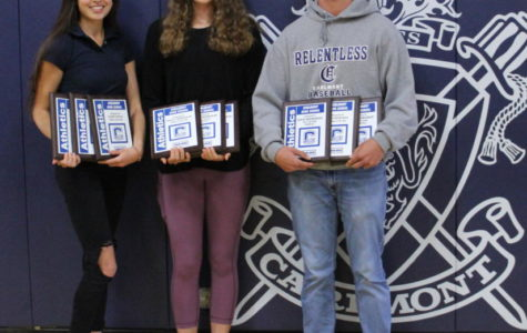 Kaimei Gescuk, Ashley Trierweiler, and David Bedrosian take a picture while holding their Athlete of the Year plaques.
