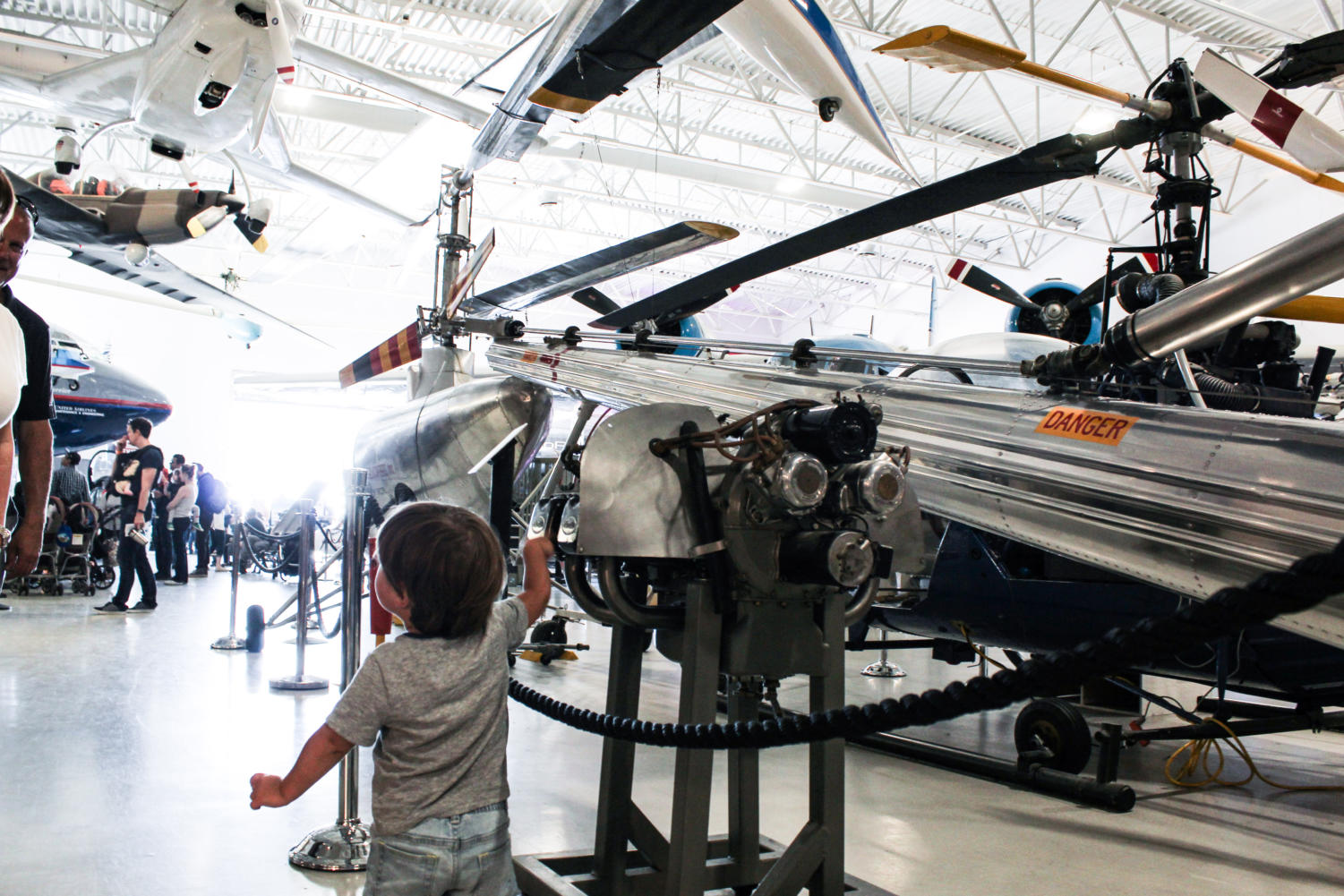 A child explores a plane exhibit in the museum.