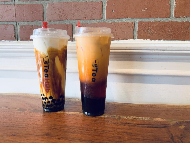 The tiger tea and Thai tea drinks stand against Tea Hub's brick walls.