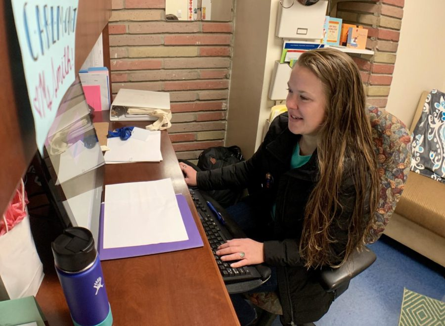 """Counselor Julia Smith prepares for student appointments in her office. """"I just really enjoy having conversations with the youth about whatever is going on for them,"""" Smith said."""