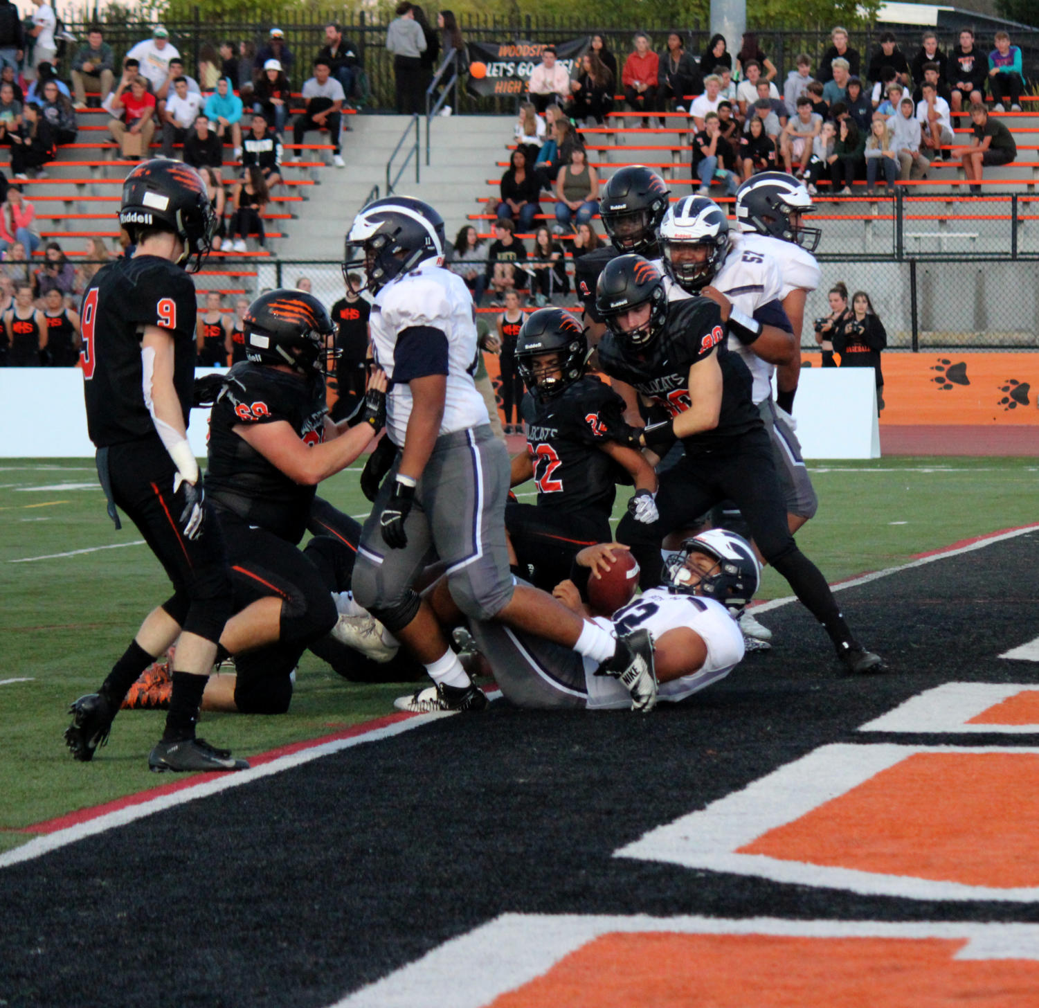 Fullback+Si%27i+Tengei%2C+a+junior%2C+dives+into+the+endzone%2C+scoring+a+touchdown+for+Carlmont.