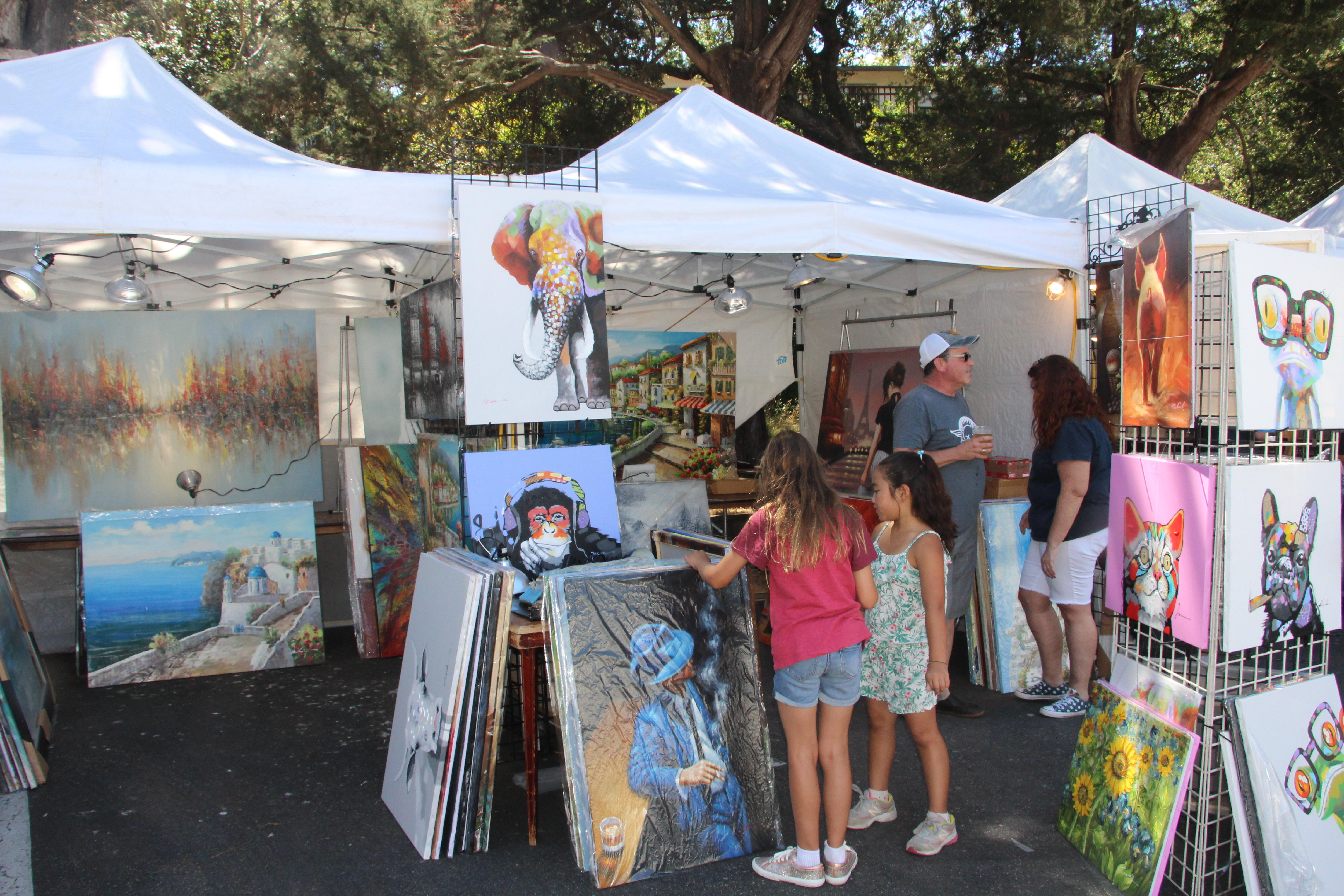 Children+and+adults+alike+admire+the+paintings+in+one+of+the+tents.