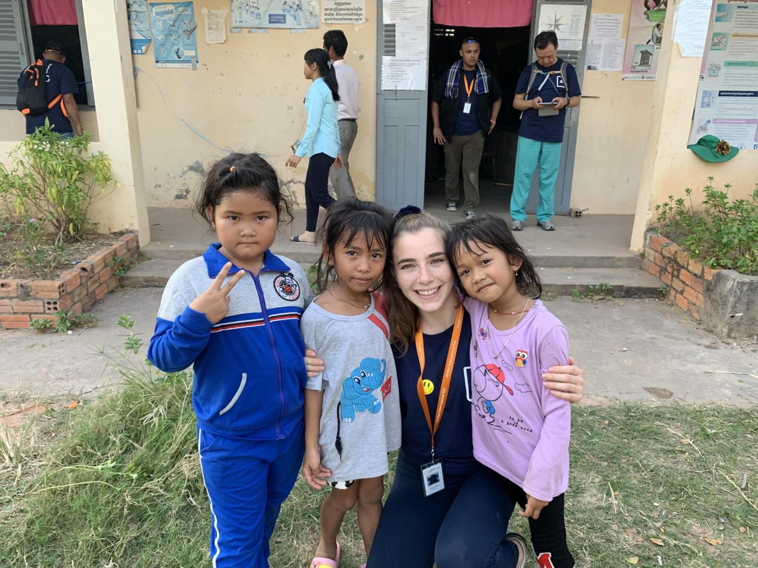 Simone Beilin poses with new friends while on her trip to Cambodia to help those without access to medical treatment.
