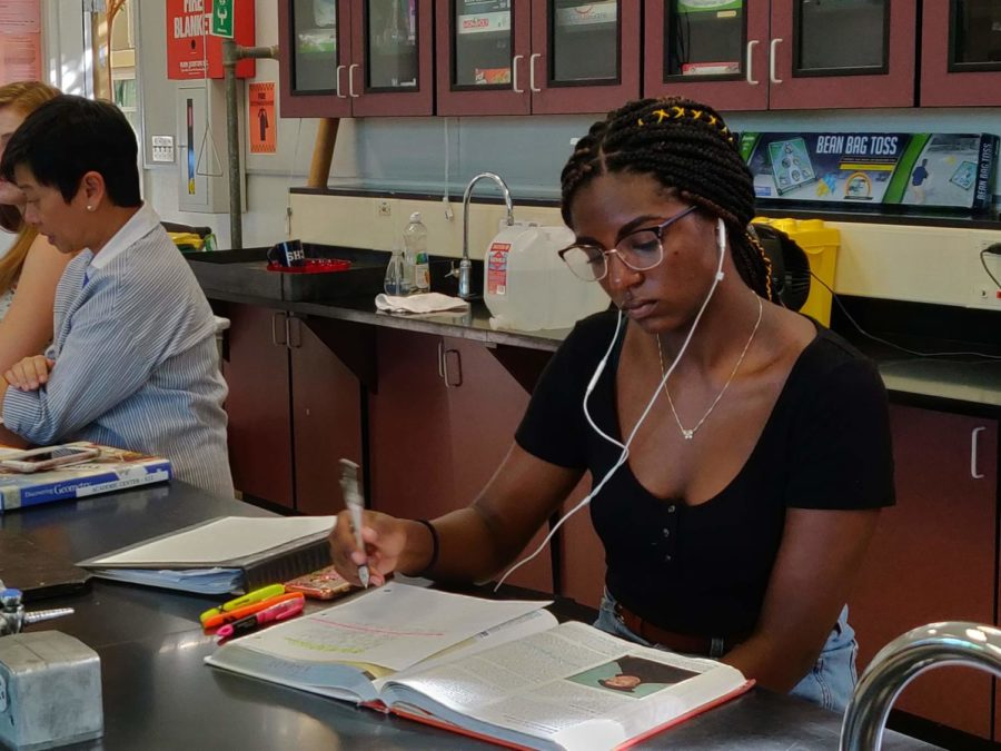 Jordan English does her history homework in the Academic Center.