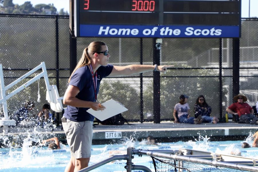 Coach+Bernice+Orwig+instructs+her+girls+varsity+water+polo+team.