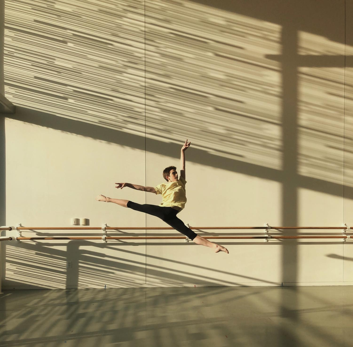 Sam Stampleman practices on strengthening his grand jeté in the dance studio.