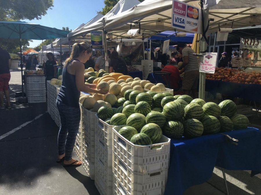 Attendee enjoys fresh produce early Sunday morning.