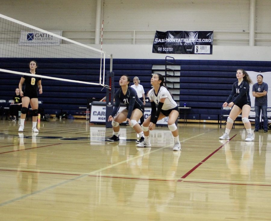 Keani Haake, a sophomore, gets in a defensive position while she waits for the spike.