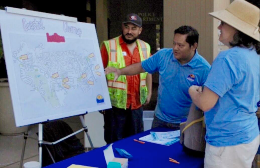 Coastal Cleanup members look over a map of the clean up site.