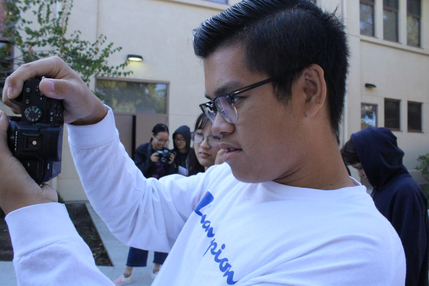 A student participates in a photography workshop during JEA  NorCal Media Day.