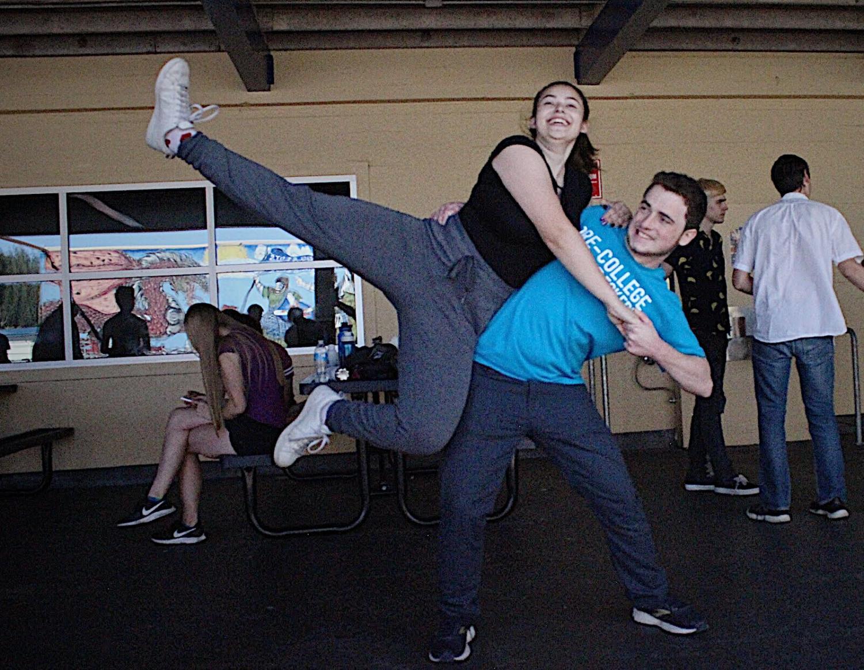 Hailey Hamady, a junior, and Thomas Covington, a senior, practice a lift for their routine.