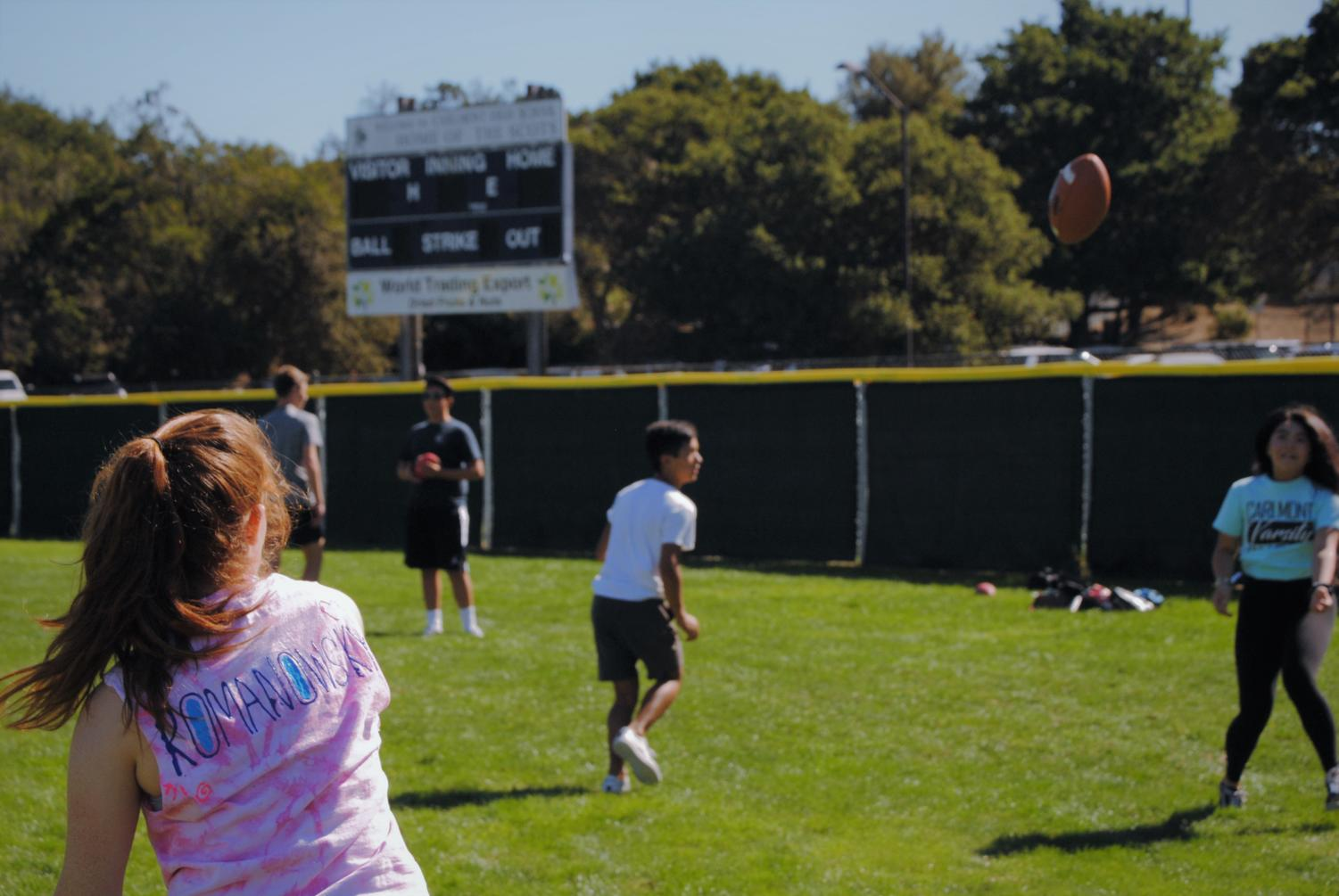 Player Lexi Romanowsky throws the football to Sophia Reyes on Saturday, Oct. 5. Romanowsky has been practicing her throws for the upcoming tournament.