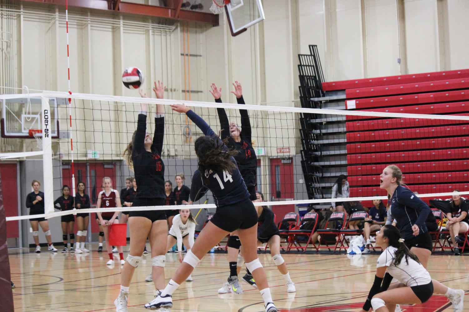 Freshman hitter Curly Raddavero spikes the ball in the first set.