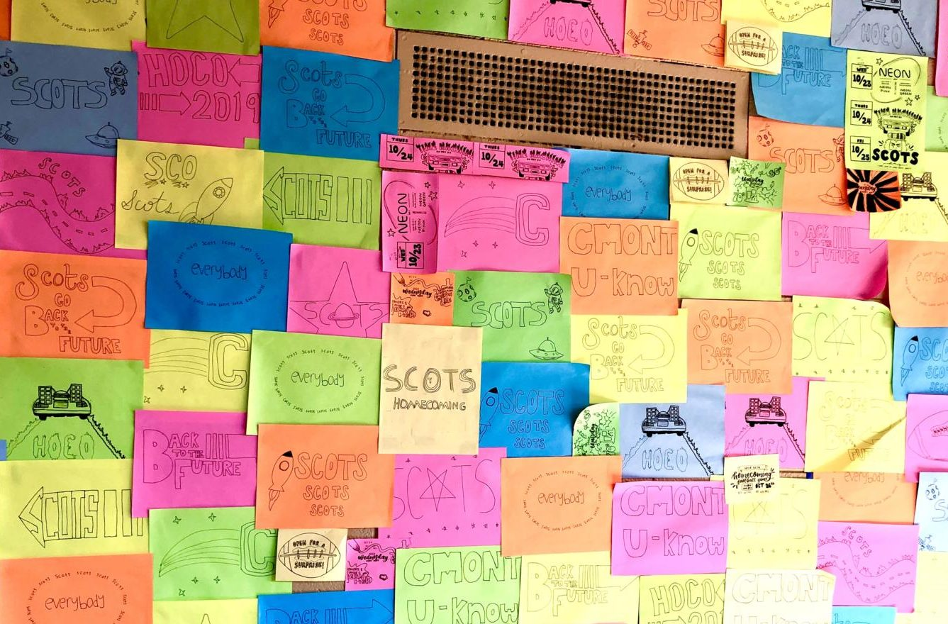 ASB's Recognition commission puts up colorful and optimistic notes and posters in C hall.