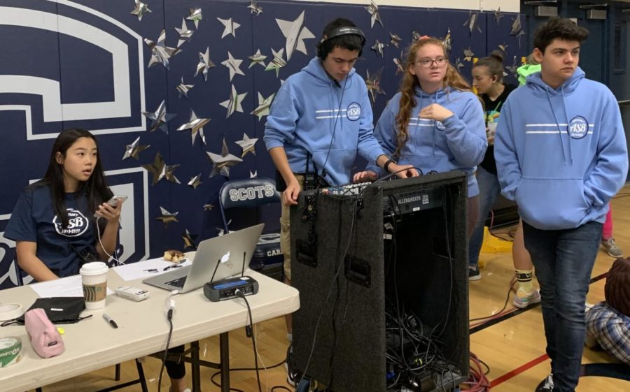 The ASB Media commission watches as the Carlmont dance teams practice their routines for the annual Homecoming assembly. Throughout the event, they play videos, music, and control the microphones used, adjusting the volumes during the performances to the best possible settings.