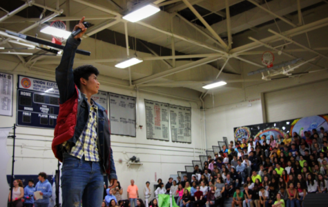 Sophomore Jono Sison energizes the crowd at the beginning of the annual homecoming assembly.