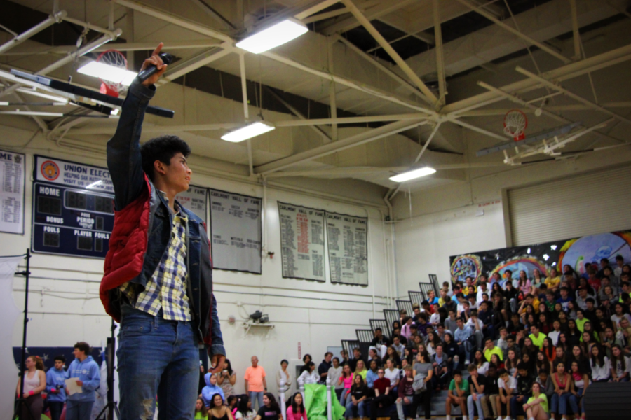 Sophomore+Jono+Sison+energizes+the+crowd+at+the+beginning+of+the+annual+homecoming+assembly.