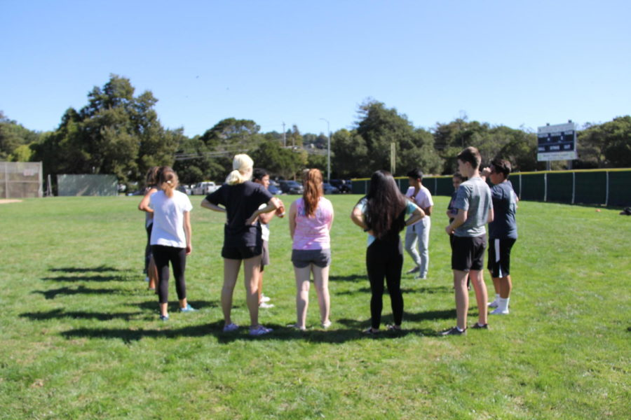 Coaches+brief+players+before+practice+on+Oct.+5.+This+was+their+first+practice+preparing+for+the+upcoming+powderpuff+tournament.