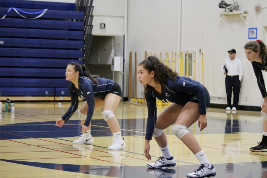 Freshman+Curly+Raddavero+and+sophomore+Aja+Teng+are+focused+as+they+wait+to+pass+the+ball.