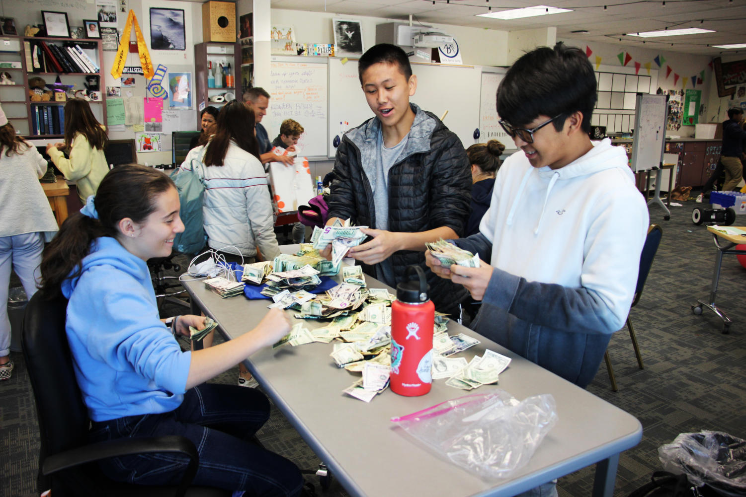 ASB's Finance commission counts money collected from Carlmont's homecoming football game.