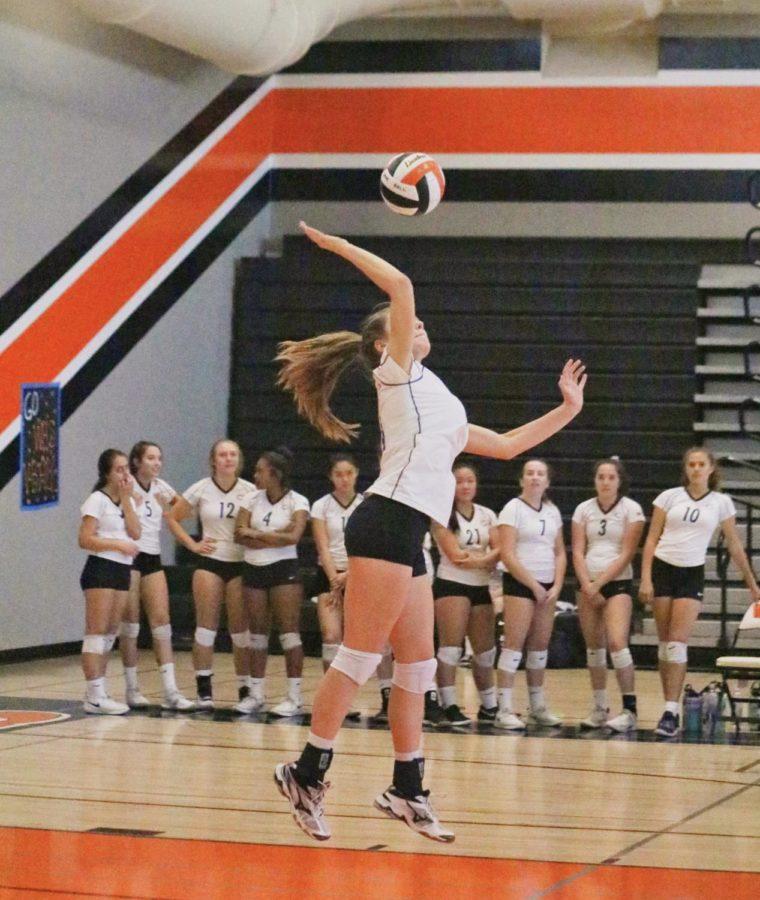 Sophomore+Nadia+Fedetova+serves+the+ball+to+the+opposing+team.