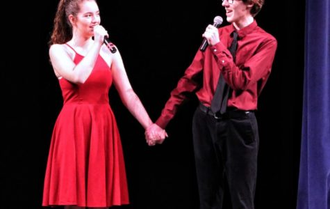Katie Mannion and Colin Welter, both seniors and co-presidents of choir, sing