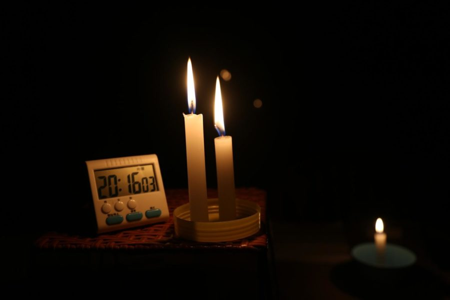 Many students resorted to completing their homework by candlelight while they waited for the power to return.
