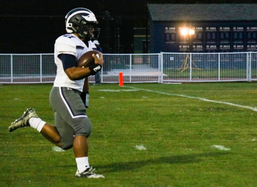 Dane+Fifita%2C+a+sophomore%2C+is+all+alone+on+a+touchdown+run+negated+by+a+penalty.