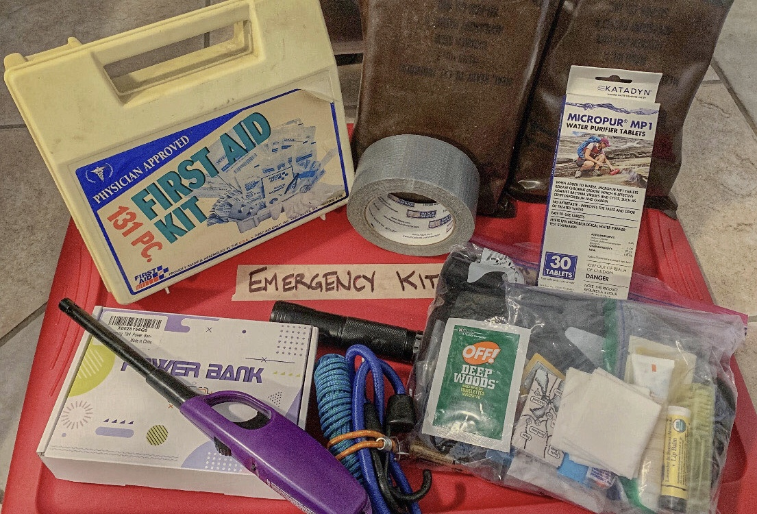 A California resident's emergency kit includes food, water, a first aid kit, and other essential supplies.