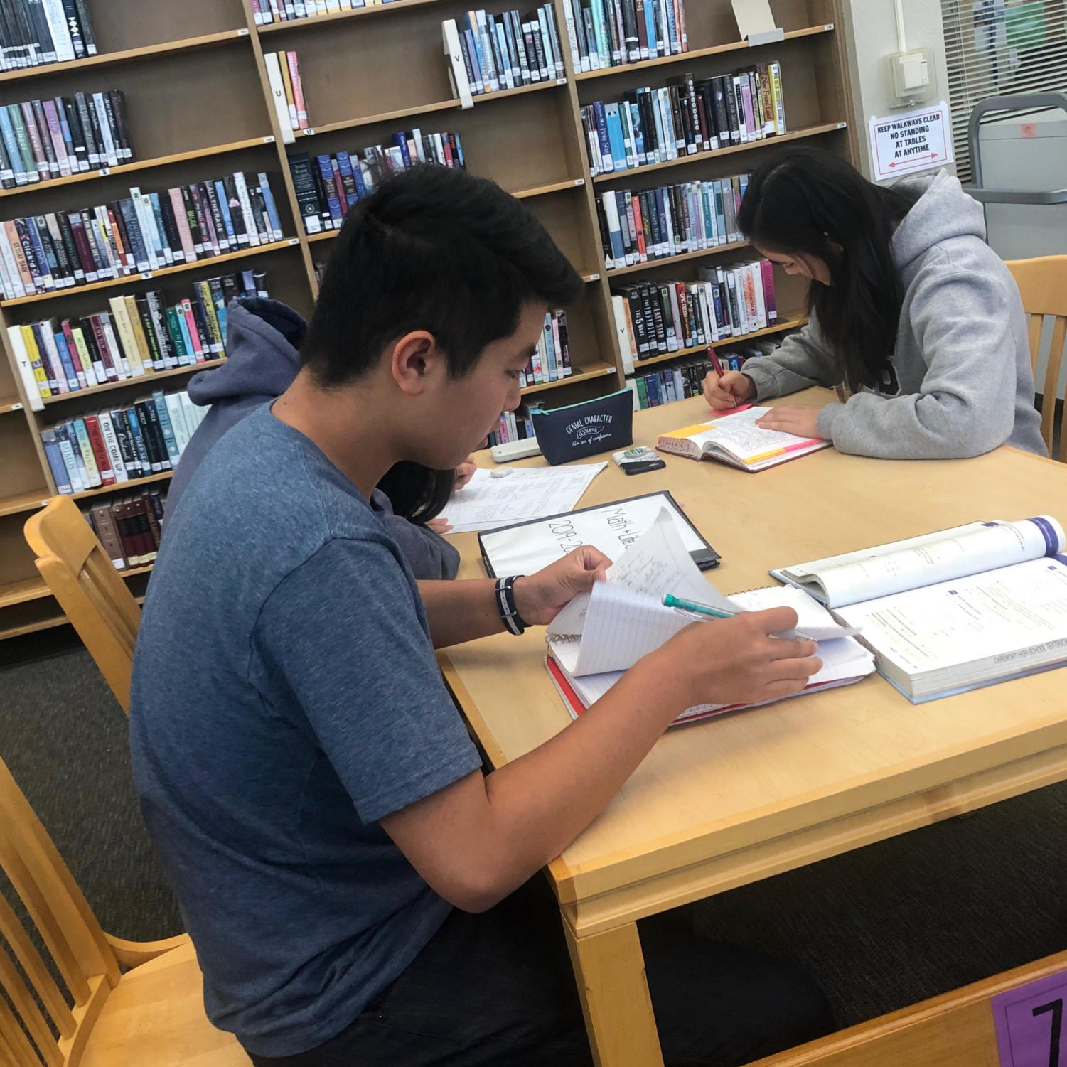 Students work on homework during lunch. Prospective freshmen have a chance to experience this life for half a day when they shadow at Carlmont.