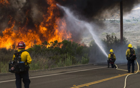 Firefighters with the Camp Pendleton Fire Department combat a fire in the Santa Margarita/De Luz Housing area on Marine Corps Base Camp Pendleton, California, July 6, 2018.(U.S. Marine Corps photo by Cpl. Dylan Chagnon)
