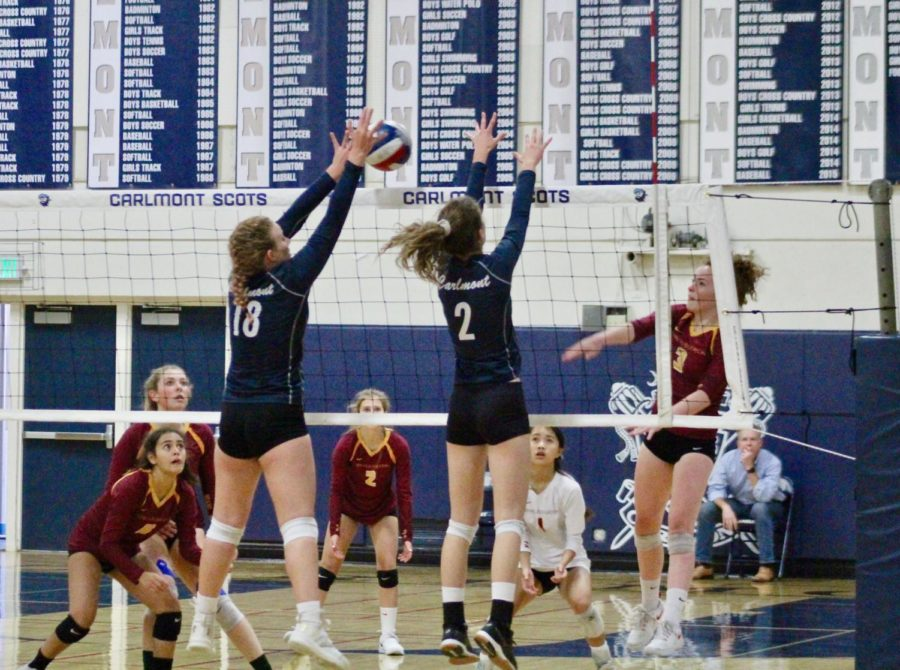 Savannah+Velschow%2C+a+sophomore%2C+and+Payton+Zolck%2C+a+sophomore%2C+jump+to+block+an+attack+from+the+opposite+team.+