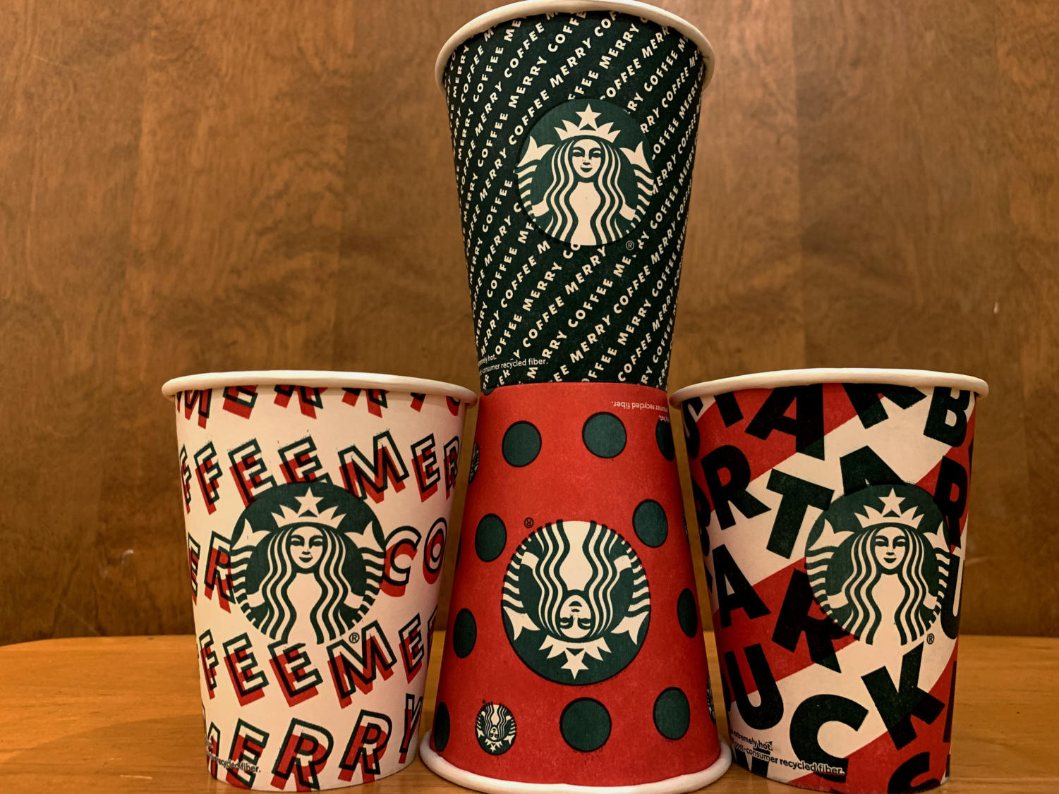 "Bold patterns grace the Starbucks cups of the 2019 holiday season.  According to Jen Quotson, vice president of Starbucks Creative, the cups are meant to represent ""a gift to Starbucks's partners and customers."""