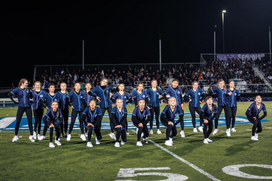 The varsity dance team performs during the halftime show.
