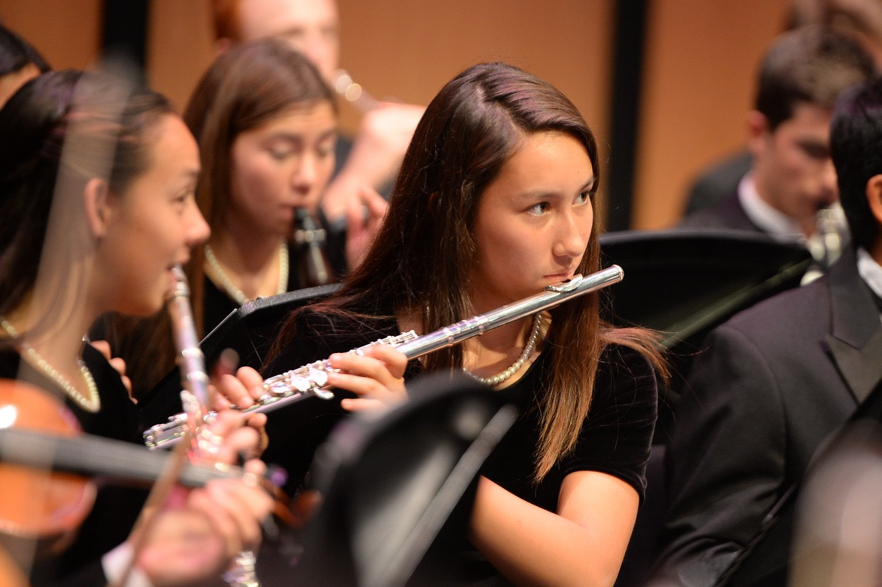 A student plays the flute in the Carlmont band.