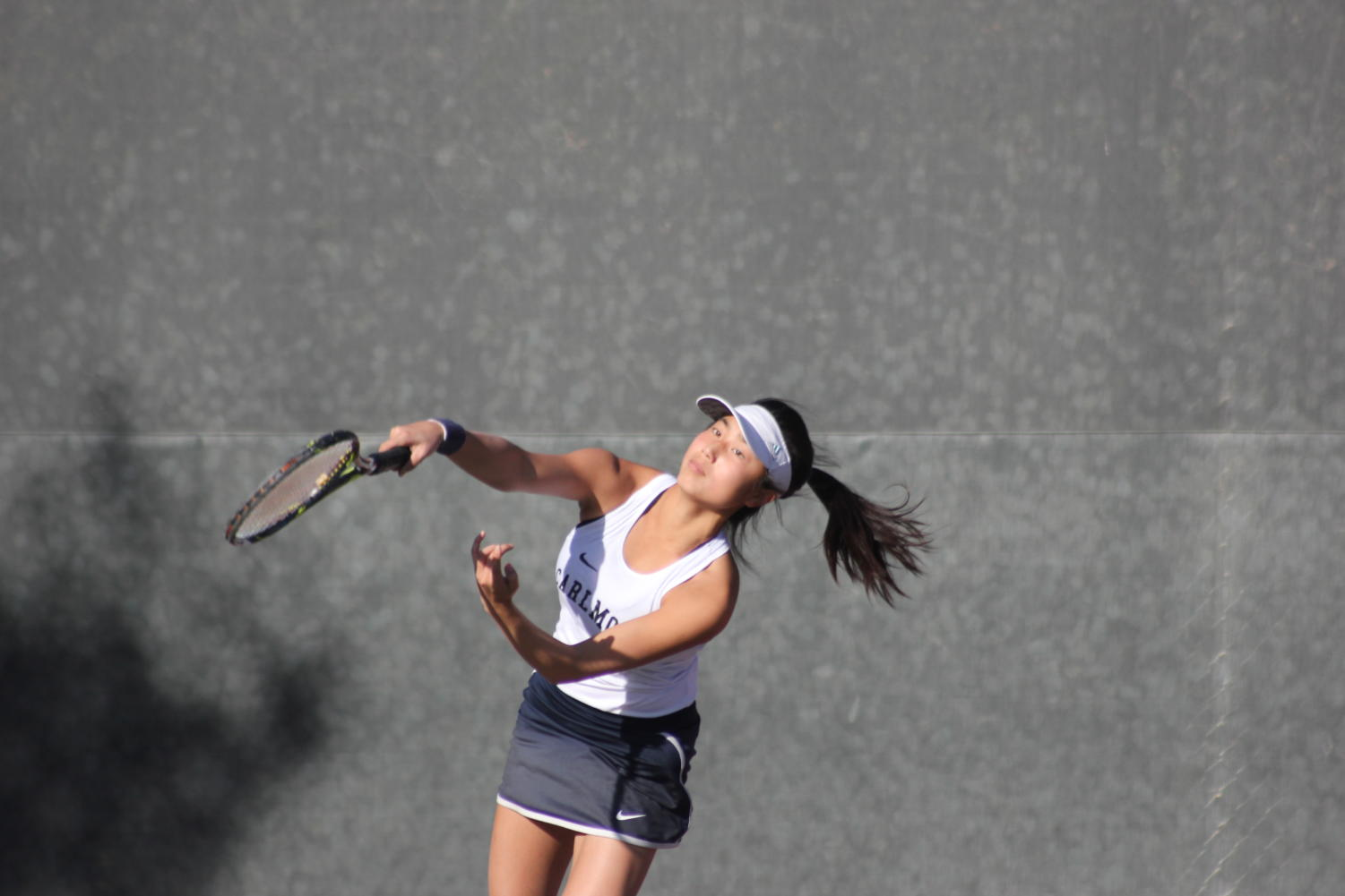 Singles one player Annika Lin aces her serve in her first match of the day.