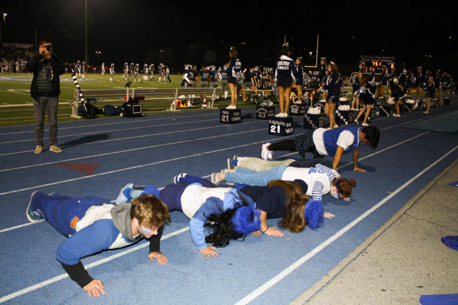Students+in+ASB+do+push-ups+after+the+Scots+score+a+touchdown.+
