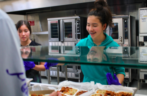 Katinka Lennemann (right) and Cori Nicholson (left) serve students in the lunch line.