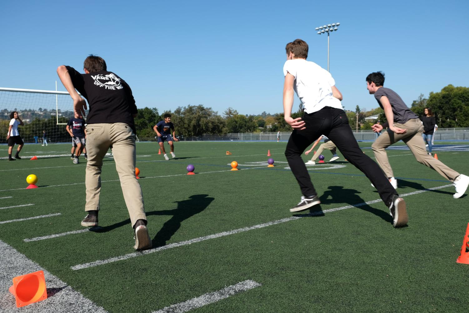 As the round began, students raced towards the line of dodgeballs.