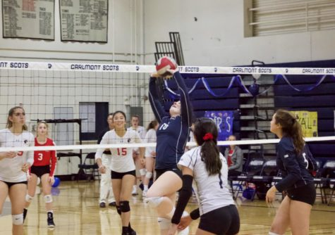 Nicole Yaravoy, a sophomore, sets the ball back to the opposing team.