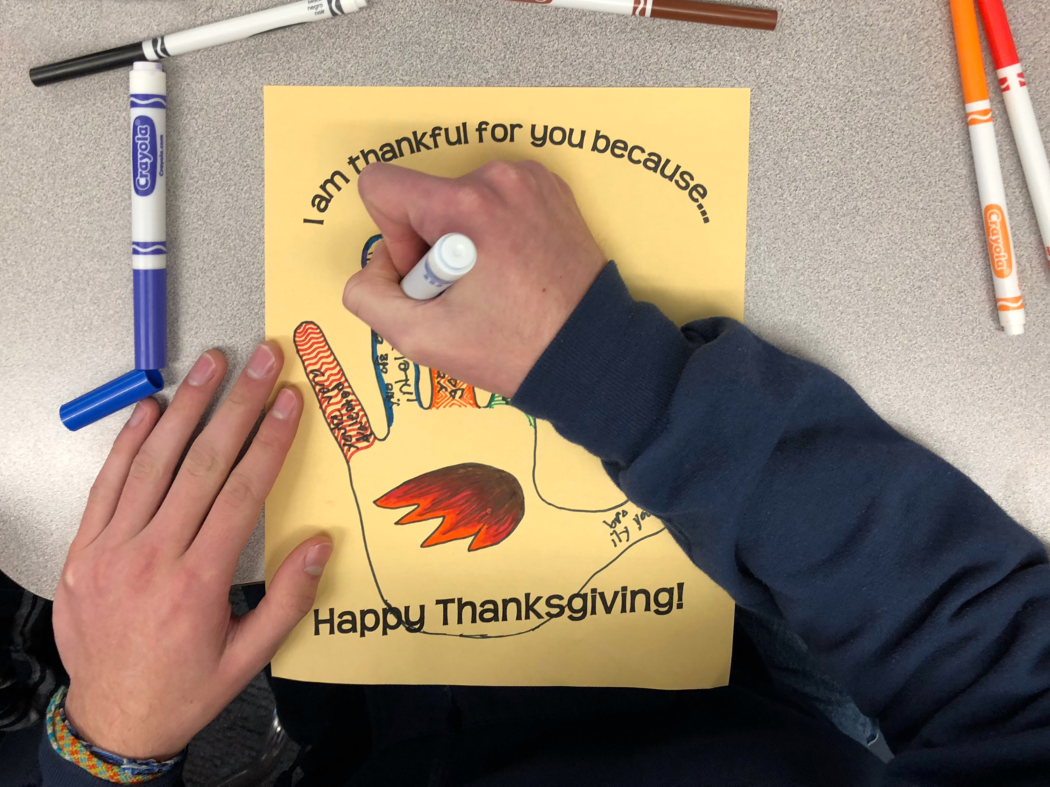 Carlmont students expressed appreciation for one another through ASB's candy corn–filled pumpkins and creating hand turkeys in class, as pictured.