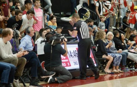 On Dec. 1 referee, Larry Scirotto, alerts the sideline of a reversed call during a Stanford vs. UNC Wilmington game.  The sideline reports the official ruling to the league.