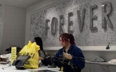 Forever 21 sales associate, Noelle De Leon, rings up a customer.