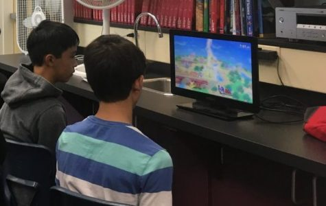 A smaller monitor set up in the corner of A10 allowed other members to play tournament matches during club meetings.