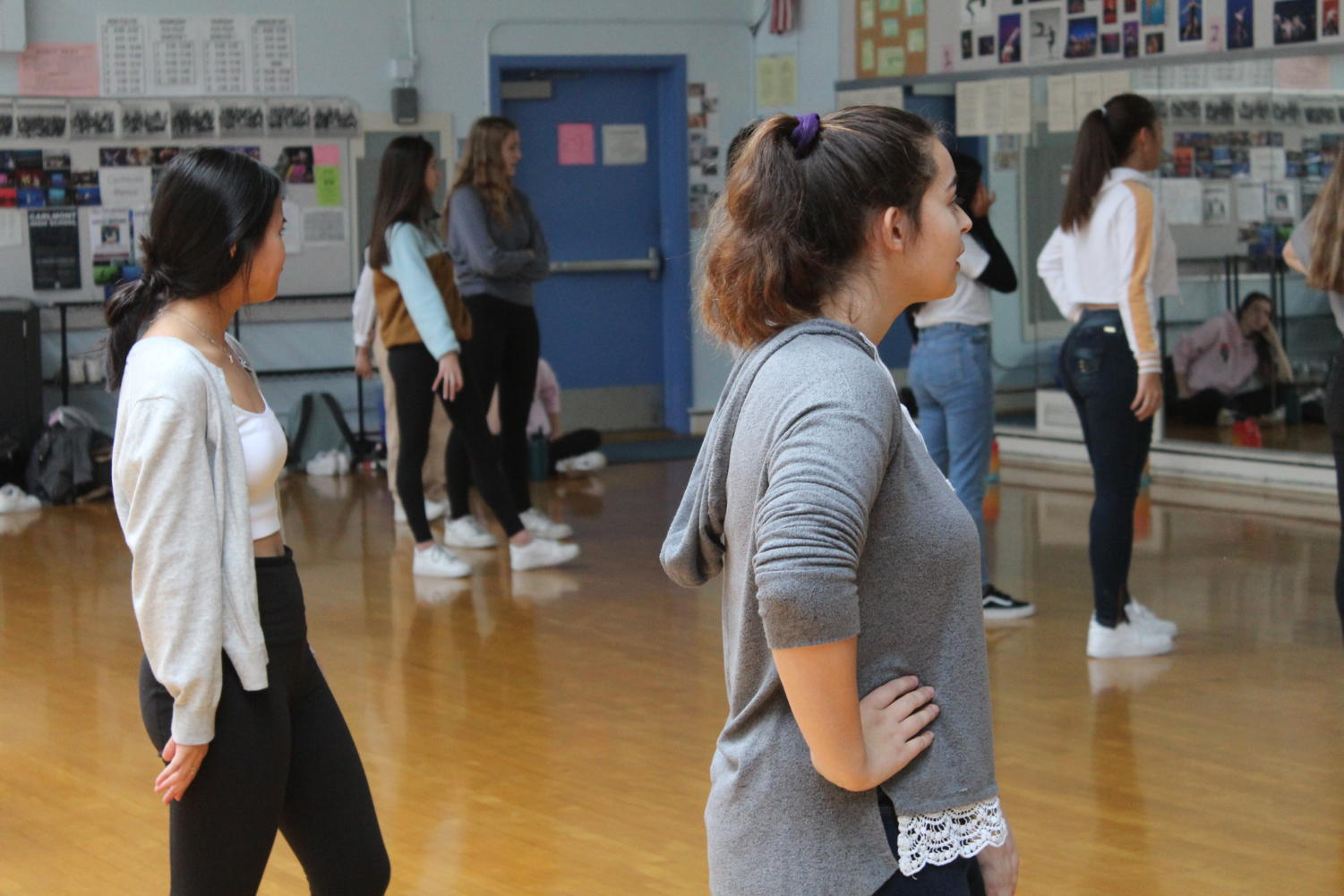 Hailey Hamady, a junior, watches as the choreographer explains the next section of the dance.