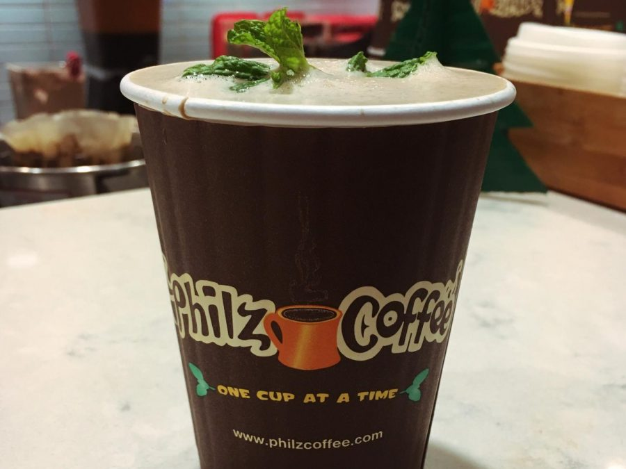 The mocha tesora is a signature Philz drink with medium-blend coffee and chocolate and caramel flavors. It can be optionally garnished with a sprig of mint.