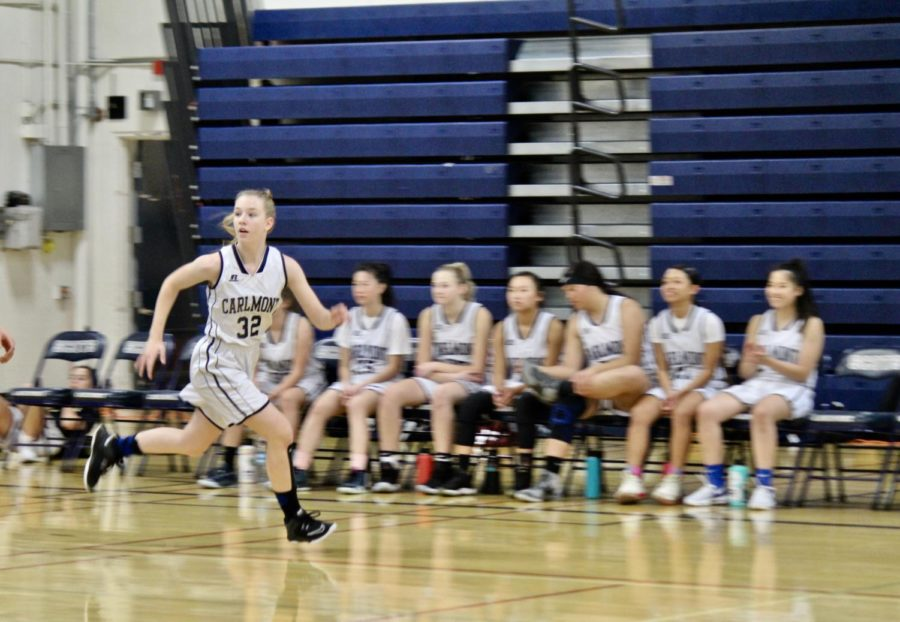 Whiting runs down the court as the team gains possession of the ball.