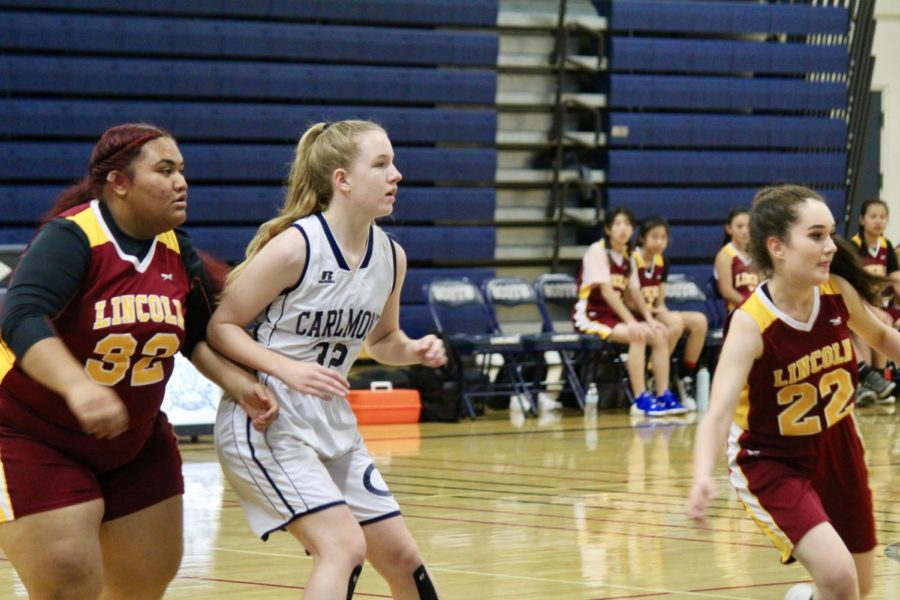 Makya Whiting guards her opponent during an intense  basketball game.